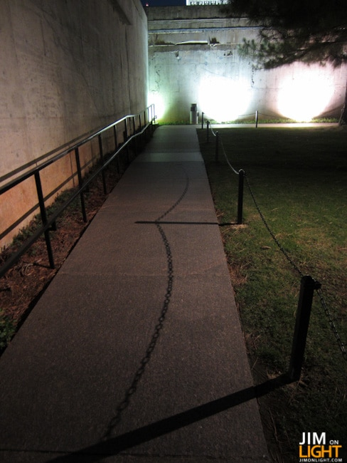 Shadows of chain near the Survivor's Wall