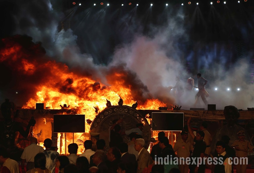 A massive fire broke out on Sunday evening during a cultural programme at Make In India week event in Mumbai. The fire broke out below the stage during the programme.Maharashtra chief minister Devendra Fadnavis and governor C Vidyasagar Rao who were present during the programme were quickly moved out of the area. Express photo by Prashant Nadkar,Mumbai, 14/02/2016